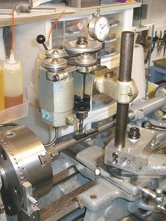 Custom mounting block on lathe compound is used to attach a Unimat DB-200 milling head to a South Bend lathe.