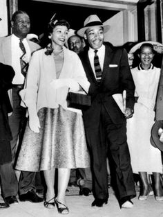 (FILES) US clergyman and civil rights leader Martin Luther KIng (C), 27, and his wife, Coretta Scott King, emerge 23 March 1956 from Montgomery Court House, following his trial on charges of conspiring to boycott segregated city buses. King was found guilty and sentenced to a 386 days of hard labor and fined $1,000 USD. King immediately appealed.