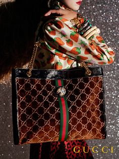7335d4644 Adorned with a tiger head fnished with colored enamel and sparkling  crystals, the Rajah totes. GUCCI®