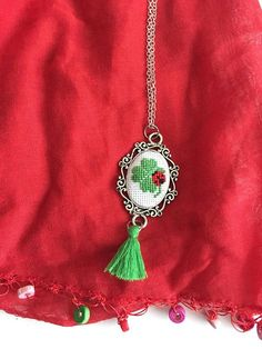 Shamrock embroidery necklace.