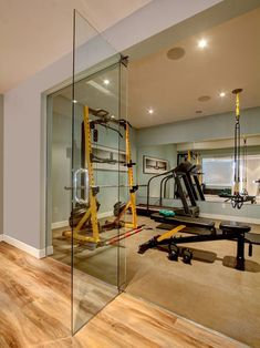 Looking for a classy entry for your home gym? Look no further with with gorgeous frame less glass door. #HomeGyms