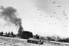 Low flying transport planes roar overhead as they carry supplies to the besieged American Forces battling the Germans at Bastogne, during the enemy breakthrough on January 1945 in Belgium. Military Units, Military History, Six Photo, World War Two, Historical Photos, Wwii, Battle, Germany, January 6