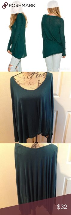 Free People Oversized Long Sleeve Tee NWOT! Free People oversized tee in a dark teal color. Scoop neck. Slight high low hem. Unfinished trims. Oversized fit - very big and comfy! 100% rayon. Free People Tops Tees - Long Sleeve