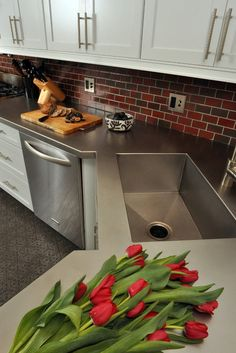 Professional-grade strength and shining beauty unite in classic stainless steel countertops for the kitchen