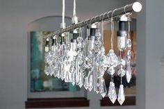 credit: Teal and Lime [http://www.tealandlime.com/2011/10/diy-linear-crystal-chandelier/]