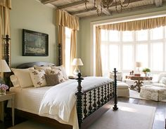 love the spindle bed the chaises and round library table in the bow window...