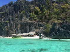 An idyllic sandy sliver of beach on Coron Island, Palawan.