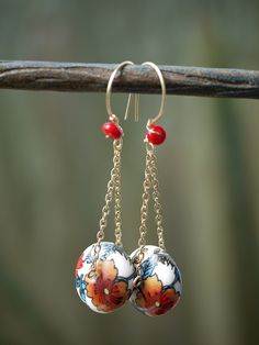 Porcelain poppies with semi precious stones by whoozqueen, via Flickr
