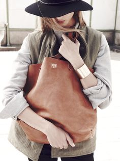 Madewell Transport Tote worn with Chimala® vest + Conor boot.