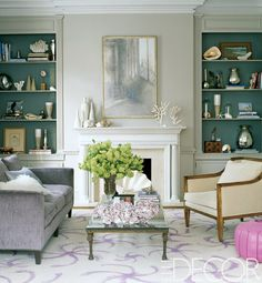 elegant living room with painted built in bookcases