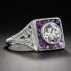 1.35 Carat Diamond and Amethyst Art Deco Ring. Art Deco diamond rings accented with sapphires, rubies, emeralds, are relatively common when compared to this rare, beautiful and feminine combination. A bright and shining European-cut diamond, weighing 1.30 carats, is framed in deep lavender (or light purple) faceted, custom-cut amethysts in this artfully ornamented, original Art Deco jewel, hand crafted in platinum - circa 1925.