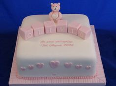 This cake is covered with fondant and topped with a blocks and toy bear. Perfect for a baby girl's christening.
