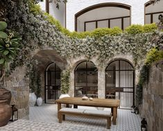 Stone combined with white brick and black frame arched doors and windows is my new dream after seeing this beauty by MHNDU Architects,… Design Exterior, Facade Design, Interior And Exterior, Outdoor Spaces, Outdoor Living, Arched Doors, Architectural Digest, My Dream Home, Future House