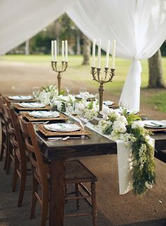 To keep a natural or rustic wedding reception theme simple, try limiting your color choices to green, white, and wood.
