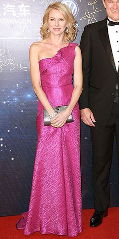 The actress goes with a super feminine look for the 15th Huading Awards in Macau, China. She pairs a fuchsia Roland ...