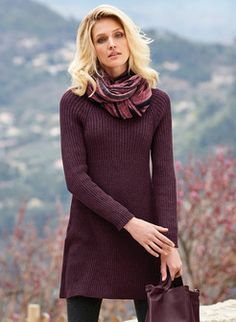 Chic sweater dressing, our Merlot pima tunic-dress is knit in a textural mix of wide and fine ribs, with a round neckline, raglan sleeves, defined empire waist and flared hemline.