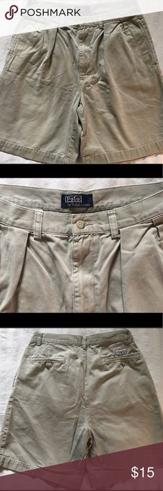 Men's Polo Chino shorts by Ralph Lauren. Khaki, 32 Excellent, pre-loved condition, classic khaki Ralph Lauren polo chino shorts. Features pleated front and two slit button pockets and back. Waist size 32, inseam 9 inches.  100% easy care cotton, smoke free and ready for your closet. No stains, no tears, no rips, no pulls. Grab these for your summer wardrobe at a bargain price! Polo by Ralph Lauren Shorts