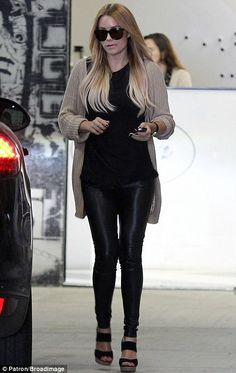 Walking tall: Lauren Conrad headed out in Beverly Hills yesterday, clad in a pair of tight-fitting leather trousers