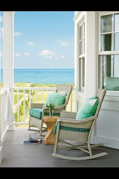 [I love that they've used rocking chairs. And that wood twist table is beautiful.] By the sea