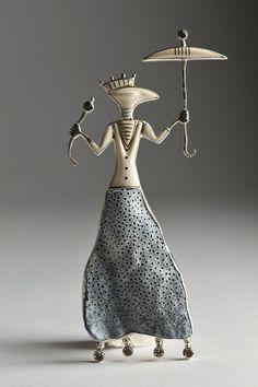 Guntis Lauders  – Silver, topaz, mammoth bone & blue coral brooch