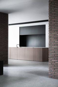Vincent Van duysen interior design ,cement flooring and wood kitchen design .