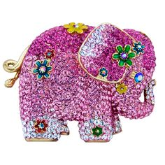 Butler & Wilson Crystal Side Elephant Brooch featuring Swarovski crystal, it fastens with a pin and revolver fastener.