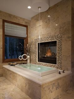 sure, i'll take a fireplace by my bathtub and water streaming from my ceiling. all necessary parts of basic nightly bathing.