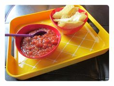The tray is heat and moisture resistant and has easy to hold handles.  I love using this tray to put drinks and snacks on during parties or movie night.