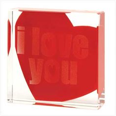 """Crystal-clear glass cube simply spells out """"I Love You"""", while a red heart beats beneath. A delightful surprise for the object of your affection!"""