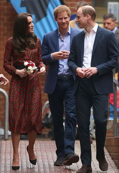 Catherine Duchess of Cambridge Prince William Duke of Cambridge and Prince Harry attends a Christmas party for volunteers at The Mix youth service on...