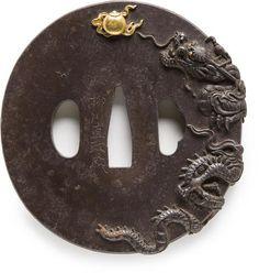 A Yanagawa Iron Tsuba With Carved Dragon After Naomasa, Edo Period (Late 18th Century).......