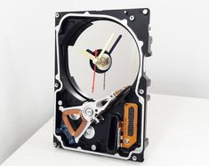 Choose a perfect recycled gift for anyone! Recycled Gifts, How To Make Wall Clock, As Time Goes By, Unique Wall Clocks, Desk Clock, Quartz Clock Mechanism, Circuit Board, Hdd, Cool Gifts
