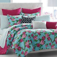 Refresh your guest room or master suite bed with this lovely cotton comforter set, showcasing a bold floral motif in blue and pink.