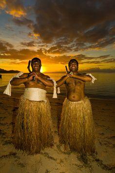 Fijian warriors at sunset, Tokokiki Island Resort, Fiji Islands