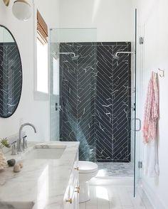 Black, white, silver bathroom. Black herringbone shower tile, white marble…