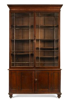Leski Auctions / Australian & Colonial - / Furniture (Australian) / Lot An early Colonial library bookcase with astragal glazed doors, Australian cedar, Tasmanian origin, circa Cedar Furniture, Colonial Furniture, Glazed Doors, Art Decor, Bottles, Bookcase, Coins, Mad, Stamps
