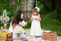This year's vintage tea party was a HUGE success. Even though it was chilly, the overcast day and lovely green setting, made for some gorgeous photos and memories.Thank you to Jen for the perfect styling and all the families for their adorable children!~Gina