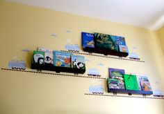 Ideas for Organizing Kids Books - make books part of the room decor with cool trail decals!