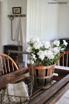 Like the look of a simple produce basket with flowers on a wood tray. Dining room centerpiece decor for fall.