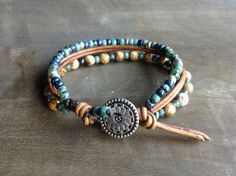 This bracelet is made with Picture jasper beads 6 mm, leather, miyuki beads and a metal button.  Table to convert from cm to inches.  15 cm = 5.905 inch. 16 cm = 6.299 inch. 17 cm = 6.692 inch. 18 cm = 7.086 inch. 19 cm = 7.480 inch. 20 cm = 7.874 inch.  Please read my policies before ordering.