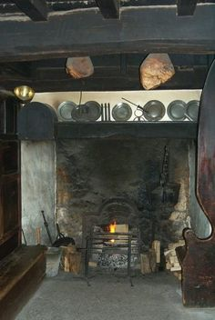 Typical of an old Welsh Inglenook fireplace. There was often a fairly big storage area to one or both sides of the main inglenook to store the firewood and help with drying it out. Peat was also a common fuel in many parts of the country. Primitive Fireplace, Inglenook Fireplace, Primitive Homes, Fireplace Hearth, Fireplaces, Kitchen Witchery, Hearth And Home, American Decor, Cottage Interiors