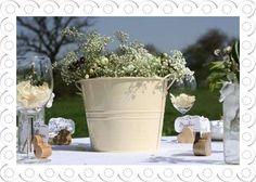 cream metal bucket for flowers