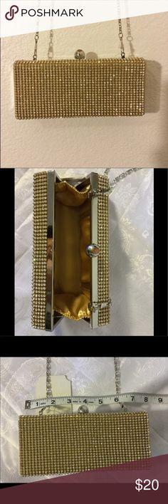 Goldtone rhinestone clutch evening bag Goldtone rhinestone evening bag/ clutch Silver removable chain Gold fabric Interior  Push-lock closure Bags Clutches & Wristlets