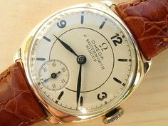 Omega gold cushion with deco dial 1937 | Vintage Watches