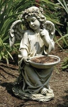 "Sitting Angel Bird Feeder Garden Figure. Beautiful angel figure sure to bring joy to the birds in your garden.  Made of Resin Stone Mix Measures 14.5""H 8.25""W 9"