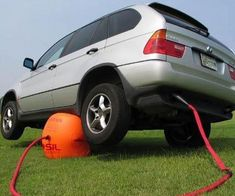 "Sick of conventional car jacks and their cliche use of leverage? Now you can fix a flat tire, look underneath your car, or just start some kind of <a href=""/images/planking.jpg"" rel=""nofollow"">weird new car posing stance</a> with ease by using your car's exhaust to power this inflatable car jack!"