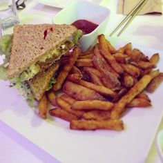 Joy & Happiness Sandwich - scrambles tofu, onion, celery, seaweed, creamy sauce, seasoning and lettuce with a side of fries. #vegan #whatveganseat #vegansofig #veganfoodshare #vegetarian #vegetariansofig #vegetarianfoodshare #vegetarianfood #igerstoronto #toronto #to #instagood #instafood #torontoeats #torontofood #fries #sandwich • Photo taken by VegansTO • http://vegansto.blogspot.ca