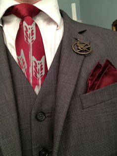 Mockingjay pins for the men and arrow print tie.