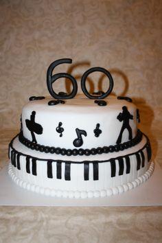 Black and white Elvis/Marilyn Monroe piano cake