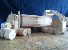 Wooden homemade toys. Toy dump truck with skid loader